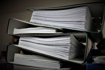 Stack of files illustrating employer record retention
