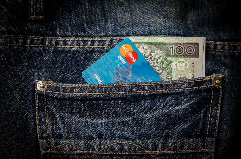 card and money in jeans pocket