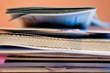 A pile of paperwork close up
